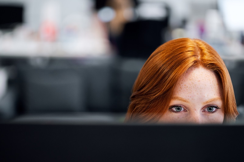 woman focused on her computer