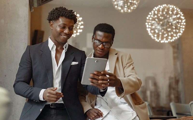 salesperson showing his tablet to a buyer