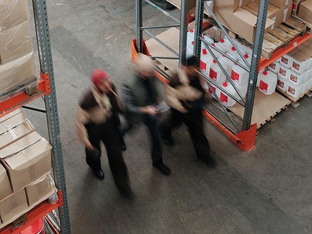 walking through warehouse